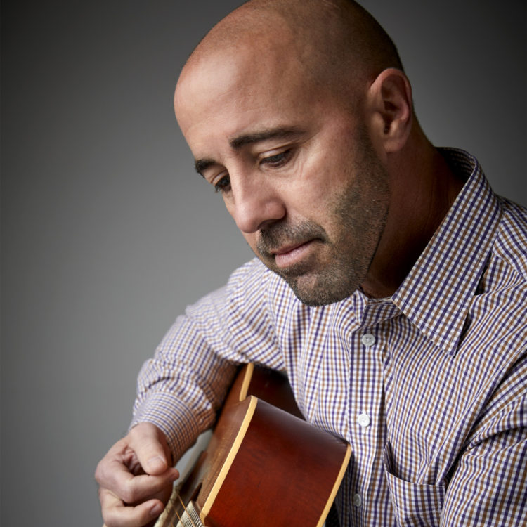 Orthodontist Darrel playing guitar